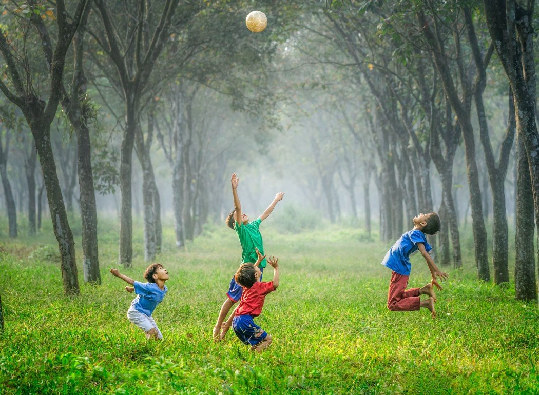 kids playing in grass